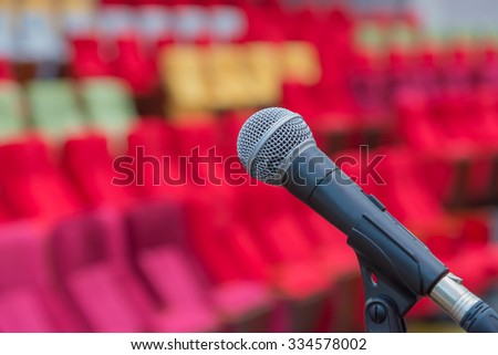 Close up of microphones in theatre or conference hall. - stock photo