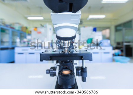 Close up of microscope at the blood laboratory - stock photo