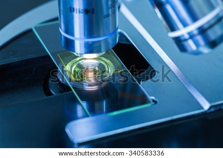 Close - up of Microscopes in Laboratory - stock photo