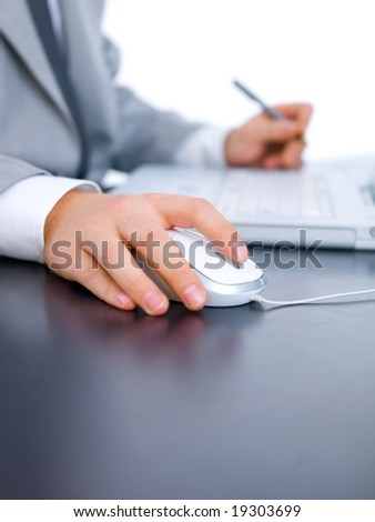 Close up of middle aged business man is working at the desk - stock photo