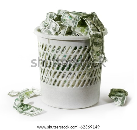 Close-up of million dollars in trash on a white background - stock photo