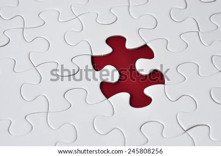 Close Up Of Missing Puzzle On Red Background, Selective Focus
