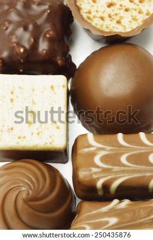 Close up of mixed chocolate pralines background - stock photo
