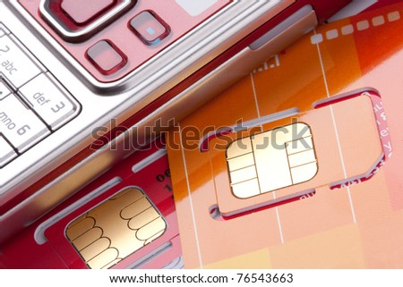 Close-up of mobile phone with sim cards - stock photo
