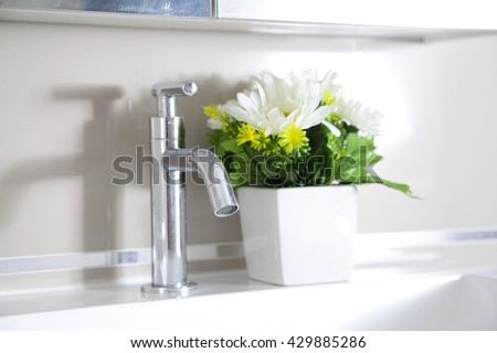 Close Up of Modern Bathroom Sink - stock photo