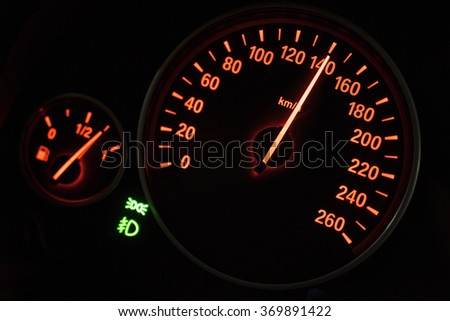 Close up of modern speedometer in car dashboard showing high rpm in high speed - stock photo