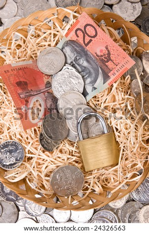 close up of money with padlock - australian currency, notes and coins - stock photo