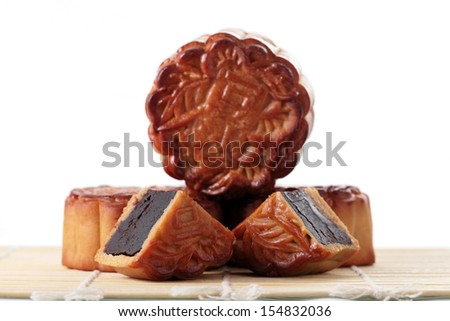 Close up of mooncakes on bamboo mat. (The chinese words indicates the type of mooncake, not the brand) - stock photo