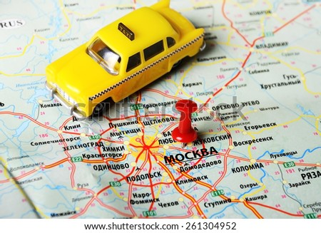 Close up of  Moscow  , Russia  map and taxi toy - stock photo