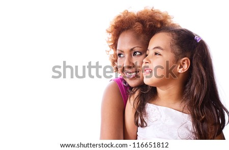 Close-up of mother and daughter, isolated on white - stock photo