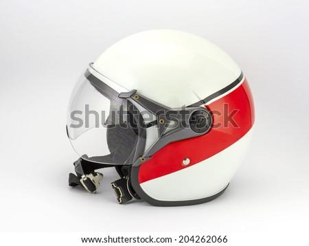 Close up of motorcycle helmet isolated on white background - stock photo