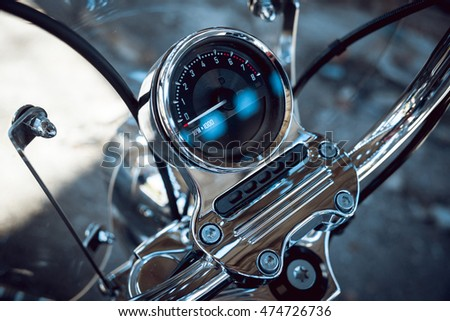 Close up of motorcycle speedometer. Chrome