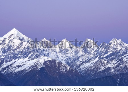 "close up of mountain ""panchachuli "" with purple backdrop"