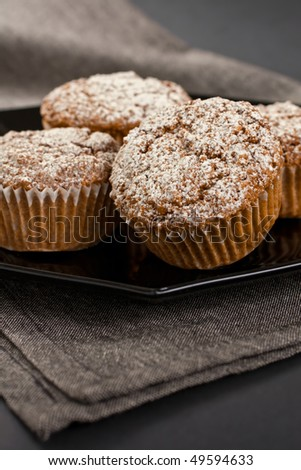 Close Up Of Muffins On A Black Plate - stock photo