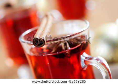 Close up of mulled wine glass with cinnamon stick - stock photo