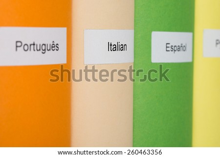 Close-up Of Multicolored Books With Different Languages - stock photo