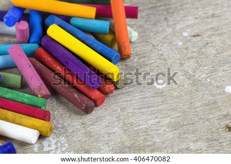 Close up of multicolored oil pastels on artist workplace - stock photo