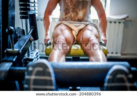 Close-up of muscular feet of a bodybuilder in the gym  - stock photo