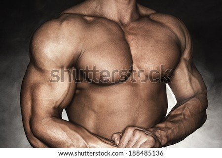 Close-up of muscular man with strong biceps - stock photo