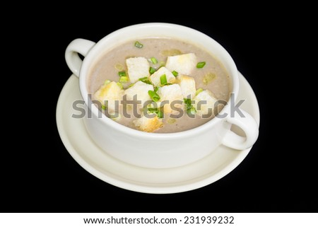 close up of mushroom soup and bread in white ceramic cup - stock photo