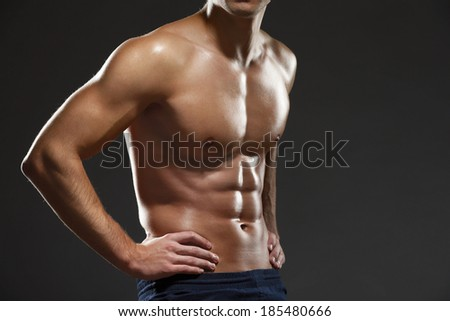 Close up of naked male's torso, isolated on black - stock photo