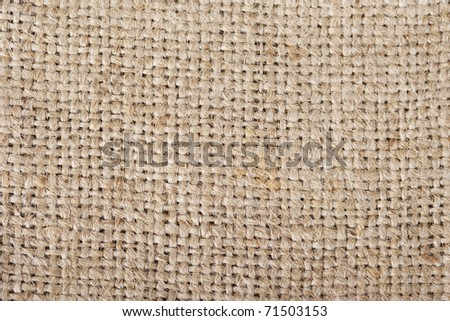 Close-up of natural burlap hessian sacking. - stock photo