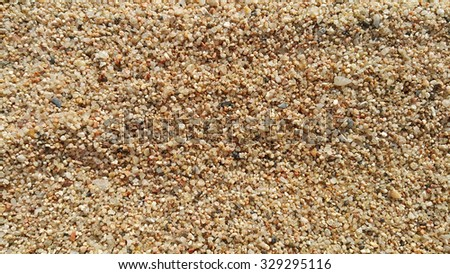 Close up of natural coarse sand background - stock photo