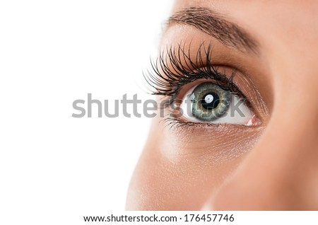 Close up of natural female eye isolated on white background - stock photo