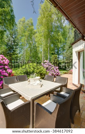 Close up of neat garden rattan table with chairs - stock photo
