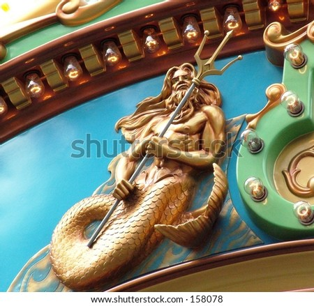 Close up of Neptune figure on carousel