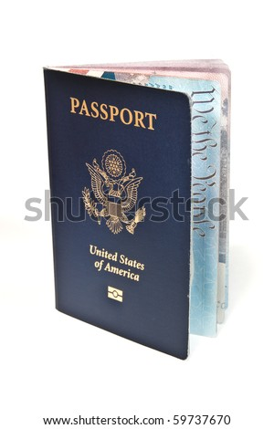 "Close up of new American Passport standing upright slightly open showing ""we are the people"" on a inside page."