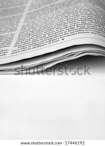 Close up of new paper article - stock photo