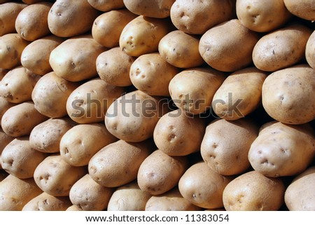 Close up of new potatoes outside a greengrocers - stock photo