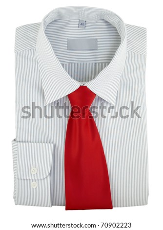 Close-up of new shirt with red silk necktie isolated over white background