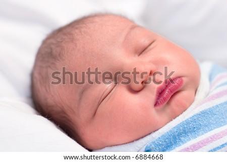 Close-up of newborn baby boy sleeping in hospital - stock photo