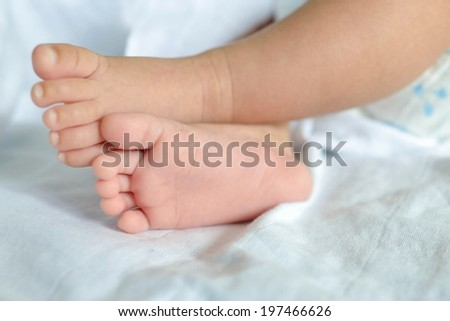 Close Up of Newborn Baby Feet - stock photo