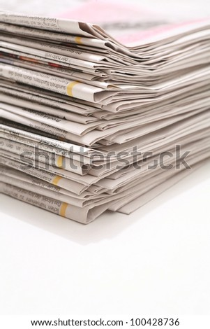 close-up of newspapers/magazine on a white backgroung. - stock photo
