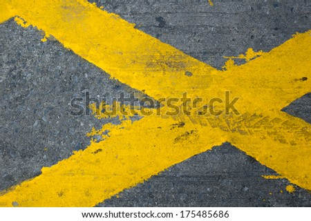 close-up of no parking cross line symbol on the road surface - stock photo