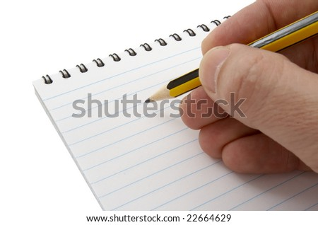close up of notebook and  hand holding pencil on white background with clipping path - stock photo