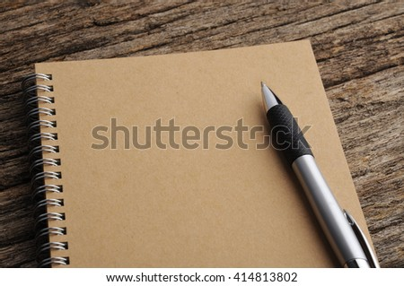 Close Up of Notebook and Pen On Wooden Background - stock photo