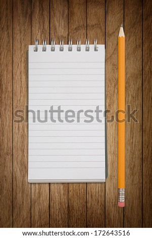Close up of notebook with pencil  - stock photo
