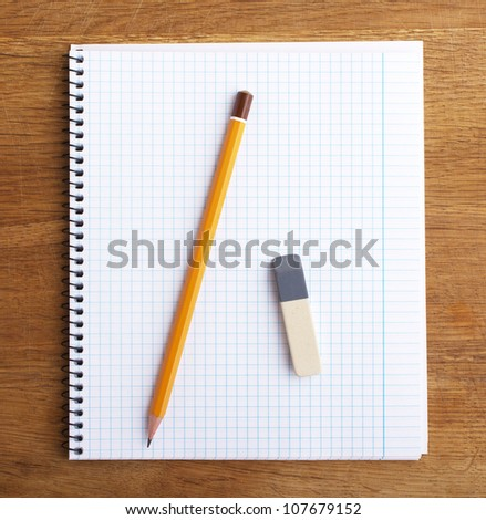 Close up of notebook with pencil and eraser