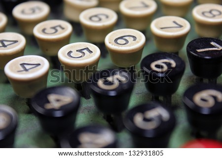 close up of number keys on antique adding machine with focus on number five