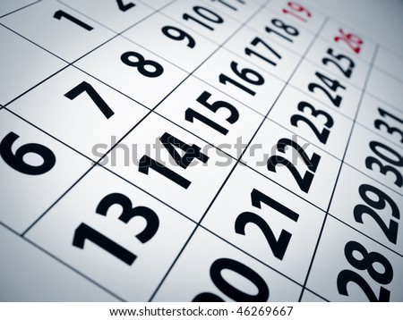 Close up of numbers on a calendar page. - stock photo