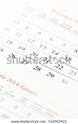 Close up of numbers on calendar page. - stock photo