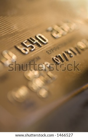 Close up of numbers on credit card - stock photo