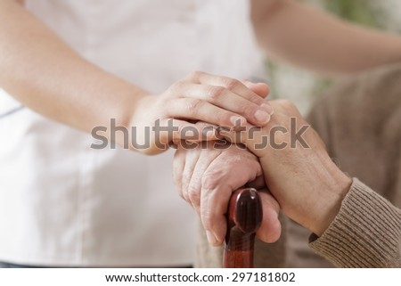 Close-up of nurse assisting ill elder man - stock photo