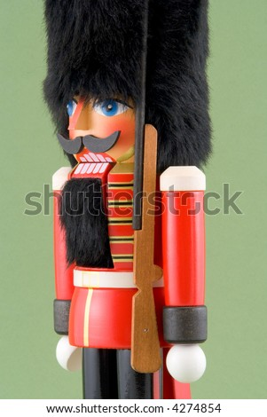 Close-up of Nutcracker Soldier Isolated on Green - stock photo