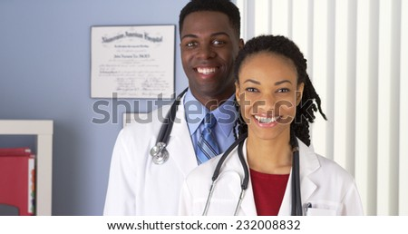 Close up of of smiling African American doctors in  - stock photo