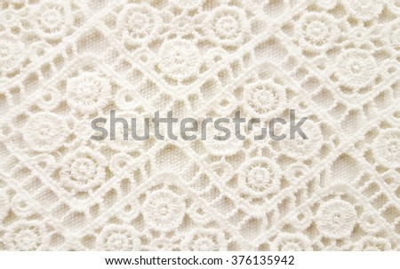 close up of off white handmade crochet pattern - stock photo